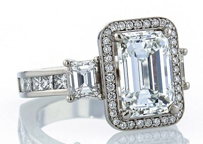 Emerald Three Stone Halo Ring